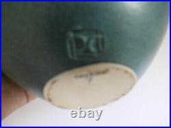 A Delan Cookson globular bottle vase. 17cm tall