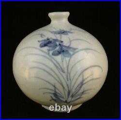 Korean blue and white vase. Flower motif, artist signed. 4 3/4 t
