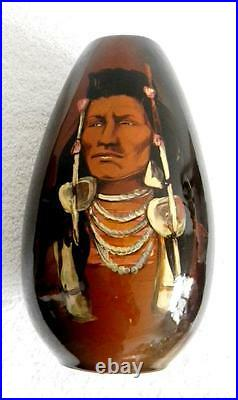 Rick Wisecarver tall art pottery vase with hand painted Indian chief